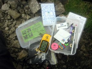 The contents of the geocache at Buckden Rake. Source: Wikipedia Commons, labelled for reuse.