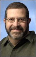 Associate professor at the Missouri School of Journalism,<br /> Charles N Davis