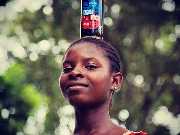 Combine cola nuts, an African village and a small company,..