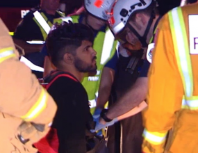 Driver trapped after driving off cliff