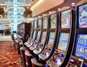 Former pokie addict sues Crown Casino