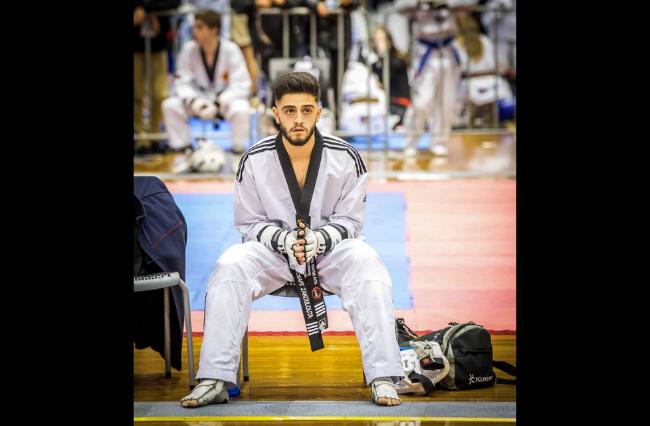 Overcoming injuries to continue his taekwondo career.
